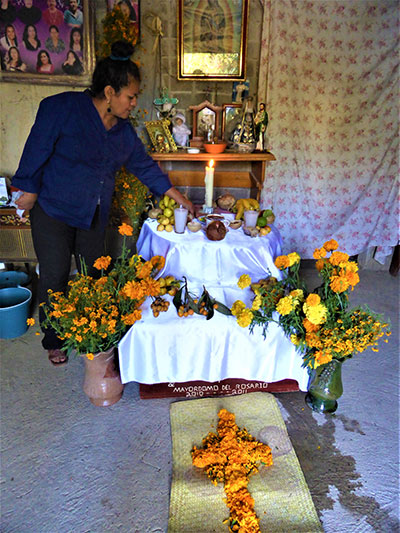 Decorating an altar for Day of the Dead, Santa Cruz Mixtepec, Mexico 2017.
